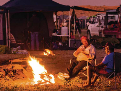 People sitting by camp fire