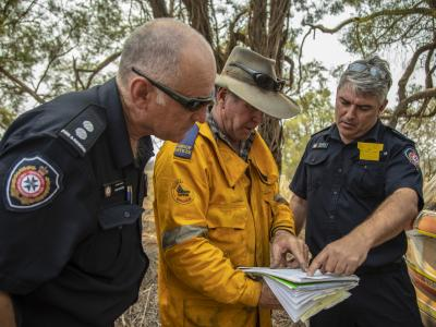 Rural fire brigade team looking at plans